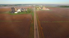 Flying over rural farms, fields, houses, on scenic foggy morning Stock Footage