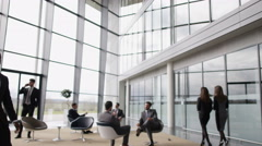 4K Business group meeting & shaking hands in busy meeting area of modern office Stock Footage