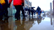 People walking in the rain in London Stock Footage