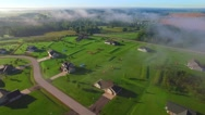 Beautiful idyllic rural neighborhood on foggy morning Stock Footage