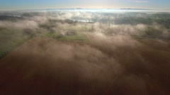 Flying over rural farms, fields, houses, on scenic foggy morning. Stock Footage
