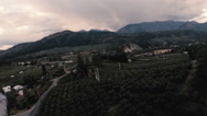 Country Aerial: Dusk/Sunset Over rural town and orchard. Stock Footage