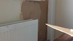 Plasterer working indoors Stock Footage