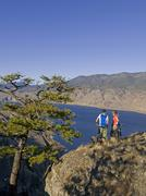 A young couple enjoying the view of Kamloops Lake while mountain biking on a Stock Photos