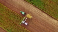 Farm machines harvesting corn Stock Footage