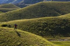 A hiker looks out over landscape, Big Muddy Badlands, Saskatchewan, Canada Stock Photos