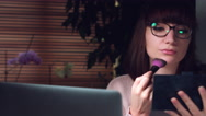4K Corporate Shot of a Business Woman Working on Computer and having Make-up Stock Footage