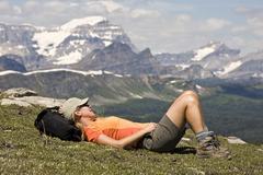 A hiker taking a break in Sunshine Meadows, Banff National Park, AB Stock Photos