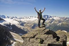 A mountain climber ascends Mt Uto in Roger's Pass, Glacier National Park, BC Stock Photos