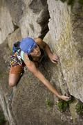 A 13 year old girl does one of first gear leads, Boa 5.3, Rattle Snake Point, ON Stock Photos