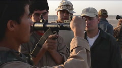 Afghan troops train with U.S. soldiers who teach them how to use RPGs. Stock Footage