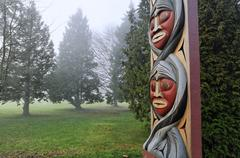 Portal post detail. Salish First Nation totem pole at Totem Park, Brockton Kuvituskuvat