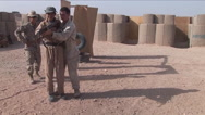 Afghan police and soldiers are taught tactics by the U.S. army. Stock Footage