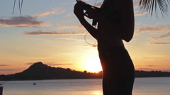 Young sports woman on the beach at sunrise background Stock Footage