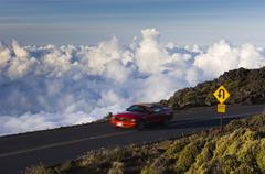 Road and clouds viewed from Haleakal_ volcano rooad, Maui, Hawaii, United States Stock Photos