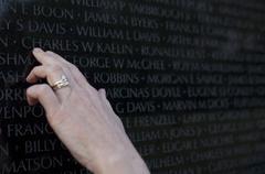 Hand on Vietnam Veterans Memorial, Washington, DC, United States Kuvituskuvat