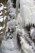 A male ice clmber tackles some steep ice in Johnstone Canyon, Banff National Stock Photos