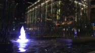 Blue water fountain night Stock Footage
