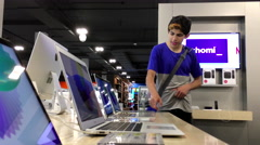 One side of people trying display Macbook computer inside Best buy store Stock Footage