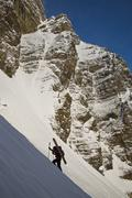 A backcountry skier hiking with ski gear, Mount Chephren, Icefields Parkway, Stock Photos