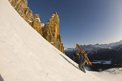 A backcountry skier hiking with ski gear, Bow Peak, Icefields Parkway, Banff Stock Photos