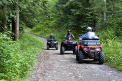 A group of ATV quad bikers take to the trails near Powell river on the upper Stock Photos