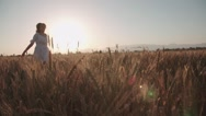 Young ,happy woman run into the arms of her boyfriend, love in the wheat field Stock Footage