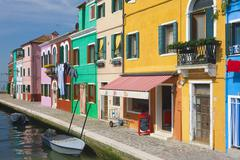 Colourful buildings lining canal, island of Burano, Venice, Italy Stock Photos