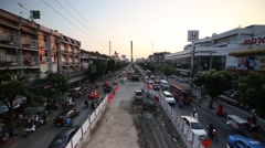 Construction of the BTS public train in center of road car moving in rush hour Stock Footage