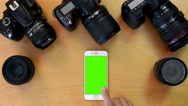 Top view of man using iphone on green screen. Stock Footage
