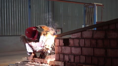 Workers are welding in the warehouse of a brick factory Stock Footage