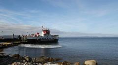 Calmac ferry departing Lochranza, Arran Scotland Stock Footage