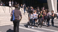 College and university students walking to classes on campus Stock Footage