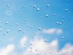 Drops of rain on window glass Kuvituskuvat