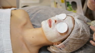 Face mask being applied during spa treatment Stock Footage