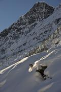 A male freeskier backcountry skiing in Roger's Pass, Glacier National Park, Stock Photos