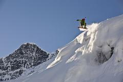 A young man splitboarding in the backcountry of Roger's Pass, Glacier National Stock Photos