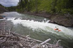 A male kayaker drops a ledge on the Highwood River, Alberta, Canada Stock Photos