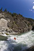 A male kayaker drops into the canyon on the Elk River, Fernie, British Columbia, Stock Photos