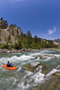 A male kayaker paddles the Wigwam River, class 4 in Fernie, British Columbia, Stock Photos