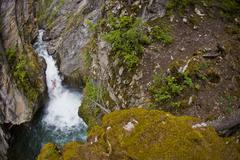 A male kayakers drops a 30 ft waterfall on Sand Creek, Galloway, British Stock Photos