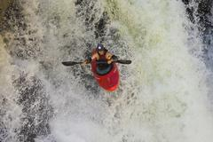 A male kayaker paddles off Raft Falls, Clearwater, British Columbia, Canada Stock Photos