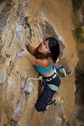 A young asian woman rockclimbing at Lost Boys crag in Jasper National Park, Stock Photos