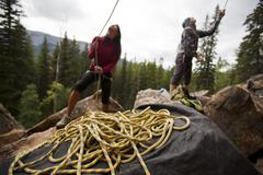 Climbers belaying at Lost Boys crag, Jasper National Park, Alberta, Canada Stock Photos