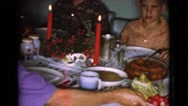 1968: carving a ham at a family christmas dinner COTTONWOOD, ARIZONA Stock Footage