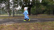Baby boy is running at the park, slow motion Stock Footage