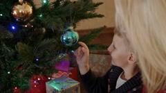 Son playing with christmas tree ball Stock Footage