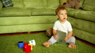 Baby boy is playing with tablet at the home Stock Footage