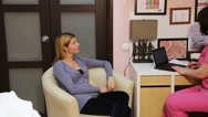 Woman on reception at doctor Stock Footage