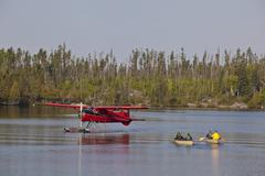 Canoeists getting picked by a float plane, Wabakimi Provincial Park, Ontario, Stock Photos